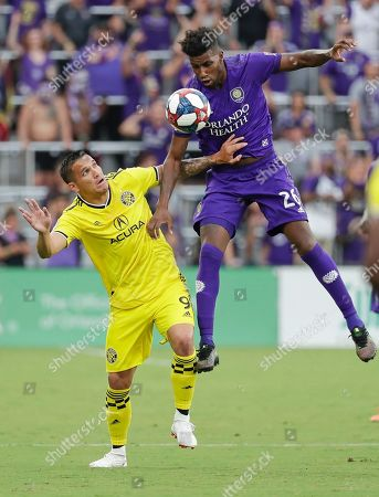 David Guzman, Carlos Ascues. Columbus Crew's David Guzman (9) and Orlando City's Carlos Ascues (26) battle for possession of the ball during the first half of an MLS soccer match, in Orlando, Fla
