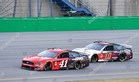 Daniel Suarez (41) tries to hold off Aric Almirola (10) during the NASCAR Cup Series auto race at Kentucky Speedway in Sparta, Ky