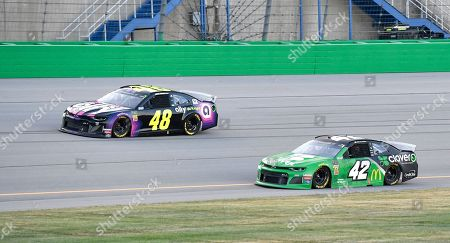 Jimmie Johnson (48) drives next to Kyle Larson (42) during the NASCAR Cup Series auto race at Kentucky Speedway in Sparta, Ky