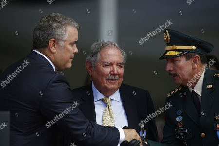 Colombian President Ivan Duque (L) greets commander of the Colombian Army General Nicacio Martinez (R) and Colombian Minister of Defense Guillermo Botero (C) in the ceremony commemorating the 100th anniversary of the Colombian Air Force (FAC) in Rionegro, Colombia, 13 July 2019.