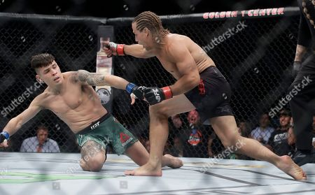 Urijah Faber, right, throws a punch at Ricky Simon during a bantamweight mixed martial arts fight at UFC Fight Night in Sacramento, Calif