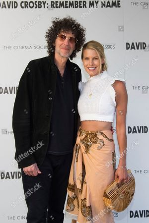 """Howard Stern, Beth Ostrosky Stern. Howard Stern, left, and Beth Ostrosky Stern attend a special screening of """"David Crosby: Remember My Name"""", hosted by Sony Pictures Classics with The Cinema Society, at the Regal UA East Hampton Cinema on in East Hampton, NY"""