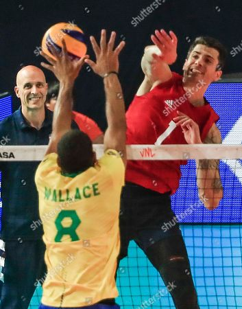 USA's head coach John Speraw (L) watches USA's Matthew Anderson (R) in action against Brazil's Wallace De Souza (C) during the FIVB Volleyball Men's Nations League semifinal match between Brazil and the USA at Credit Union 1 Arena in Chicago, Illinois, USA, 13 July 2019. Russia defeated Poland to reach the finals.