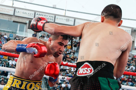 Stock Photo of Ronny Rios of the US (L) in action against Diego de la Hoya of Mexico (R) during their NABF and WBA Gold Super Bantamweight Title fight at Dignity Health Sports Park in Carson, California, USA, 13 July 2019.