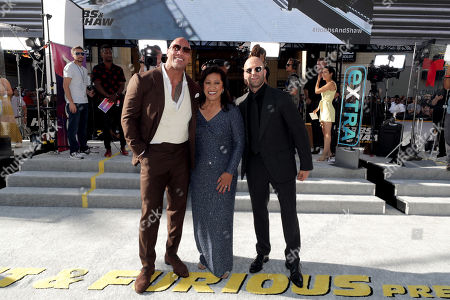 Stock Picture of Dwayne Johnson, Ata Johnson and Jason Statham seen at Universal Pictures World Premiere of FAST & FURIOUS PRESENTS: HOBBS & SHAW at the Dolby Theater in Hollywood, CA on Saturday, July 13th, 2019.