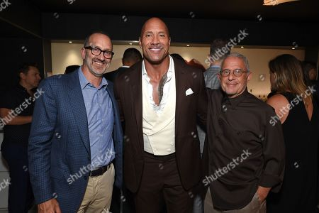 Stock Photo of Jimmy Horowitz, President of Universal Pictures, Dwayne Johnson and Ron Meyer, Vice Chairman of NBCUniversal
