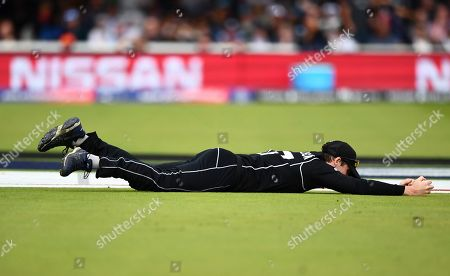 Lockie Ferguson of New Zealand catches England captain Eoin Morgan out for 9