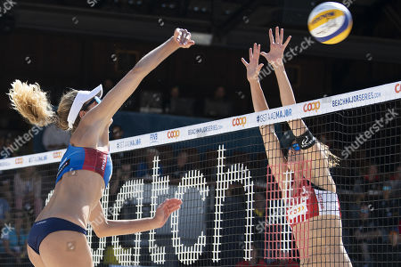 Tanja Hueberli (R) in action against Alix Klineman of the United States during the semi final at the Beachvolley Worldtour Major Series in Gstaad, Switzerland, 14 July 2019.