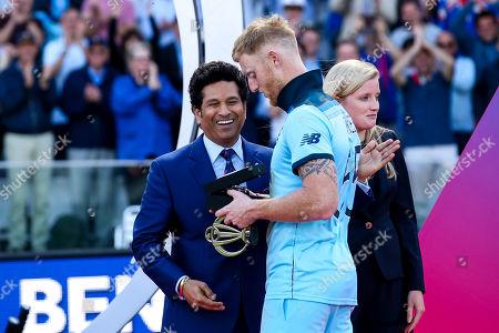 Ben Stokes of England receives his Man of the Match award from Sachin Tendulkar