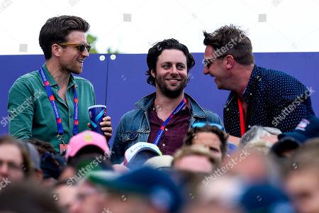 Former Maccabees guitarist Felix White, Radio 1 DJ Greg James and Matt Horan Aka Mattchin Tendulkar watch on during the Cricket World Cup Final between England and New Zealand