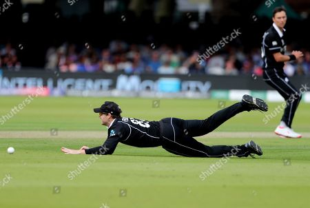New Zealand's Lockie Ferguson falls in an attempt to stop the ball after a shot played by England's Jonny Bairstow during the Cricket World Cup final match between England and New Zealand at Lord's cricket ground in London, England