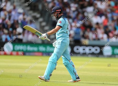 England's Jonny Bairstow reacts as he leaves the field after being dismissed by New Zealand's Lockie Ferguson during the Cricket World Cup final match between England and New Zealand at Lord's cricket ground in London, England