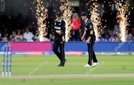 New Zealand's Lockie Ferguson, left, and Matt Henry share a light moment during the Cricket World Cup final match between England and New Zealand at Lord's cricket ground in London, England