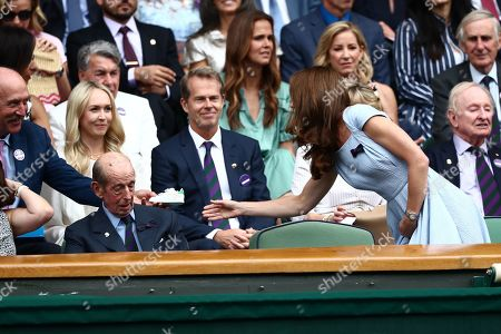 Stan Smith hands Catherine Duchess of Cambridge a signed Adidas Stan Smith trainer signed for Prince Louis
