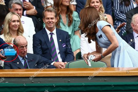 Stan Smith hands Catherine Duchess of Cambridge signed Adidas Stan Smith trainers (circled) signed for Prince Louis