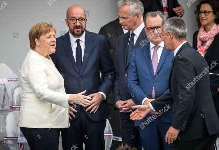 (L-R) German Chancellor Angela Merkel , Belgian Prime Minister Charles Michel, French Finance Minister Bruno Le Maire, French Assembly President Richard Ferrand and NATO Secretary General Jens Stoltenberg attend the annual Bastille Day military parade on the Champs Elysees avenue in Paris, France, 14 July 2019. Bastille Day, the French National Day, is held annually on 14 July to commemorate the storming of the Bastille fortress in 1789.