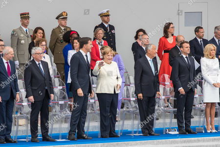 (L-R) British Chancellor of the Duchy of Lancaster and Minister for the Cabinet Office David Lidington, European Commission president Jean-Claude Juncker, Dutch Prime Minister Mark Rutte, German Chancellor Angela Merkel, Portugal's President Marcelo Rebelo de Sousa, French President Emmanuel Macron and his wife Brigitte Macron attend the annual Bastille Day military parade on the Champs Elysees avenue in Paris, France, 14 July 2019. Bastille Day, the French National Day, is held annually on 14 July to commemorate the storming of the Bastille fortress in 1789.