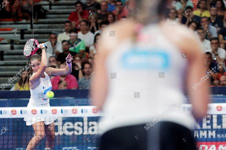 Stock Photo of Spanish paddle tennis players Marta Ortega (L) and Marta Marrero (unseen) face Alejandra Salazar and Ariana Sanchez during the Valencia Open 2019 tournament's final game at Fuente San Luis pavilion, in Valencia, eastern Spain, 14 July 2019.