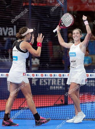 Stock Picture of Spanish paddle tennis players Marta Ortega (R) and Marta Marrero (L) celebrate after defeating Alejandra Salazar and Ariana Sanchez in the Valencia Open 2019 tournament's final game at Fuente San Luis pavilion, in Valencia, eastern Spain, 14 July 2019.