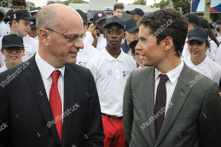 French Junior Minister for Education Gabriel Attal (R) and French Education and Youth Affairs Minister Jean-Michel Blanquer (L) pose with members of the civic service and the universal national service SNU (Service National Universel) at the end of the annual Bastille Day military parade down the Champs Elysees avenue in Paris, France, 14 July 2019. Bastille Day, the French National Day, is held annually on 14 July to commemorate the storming of the Bastille fortress in 1789.