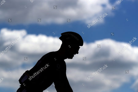 Slovakia's Peter Sagan wearing the best sprinter's green jersey is silhouetted at the start of the ninth stage of the Tour de France cycling race over 170.5 kilometers (105.94 miles) with start in Saint Etienne and finish in Brioude, France