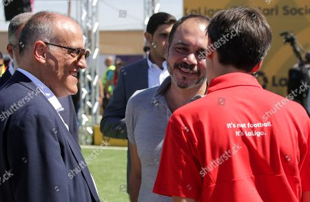 Javier Tebas, President of La Liga (L) and Jordan's Prince Ali Bin Al-Hussein, founder of  the AFDP (Asian Football Development Project) (C) chat with a staff member during a celebration of La Liga socio-educational project, at the Big Sports House Stadium, in the Zaatari refugee camp, about 100 km north of Amman, Jordan, 14 July 2019. Zaatari refugee camp is only 10 km away from the Syrian border and houses some 80000 refugees, fifty per cent of whom are under the age of 18. The Zaatari socio-educational project was developed by La Liga in collaboration with the AFDP (Asian Football Development Project), it involves some 33 clubs of the Spanish League and aims to develop various projects favorable to coexistence, integration and adaptation of the participants and their families.