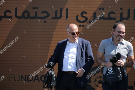 Javier Tebas, President of La Liga (L) and Jordan's Prince Ali Bin Al-Hussein, founder of  the AFDP (Asian Football Development Project) (R) react as they take part in a celebration of La Liga socio-educational project, at the Big Sports House Stadium, in the Zaatari refugee camp, about 100 km north of Amman, Jordan, 14 July 2019. Zaatari refugee camp is only 10 km away from the Syrian border and houses some 80000 refugees, fifty per cent of whom are under the age of 18. The Zaatari socio-educational project was developed by La Liga in collaboration with the AFDP (Asian Football Development Project), it involves some 33 clubs of the Spanish League and aims to develop various projects favorable to coexistence, integration and adaptation of the participants and their families.