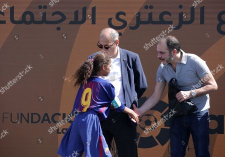 Javier Tebas, President of La Liga (L) and Jordan's Prince Ali Bin Al-Hussein, founder of  the AFDP (Asian Football Development Project) (R) greet a benficiary during a celebration of La Liga socio-educational project, at the Big Sports House Stadium, in the Zaatari refugee camp, about 100 km north of Amman, Jordan, 14 July 2019. Zaatari refugee camp is only 10 km away from the Syrian border and houses some 80000 refugees, fifty per cent of whom are under the age of 18. The Zaatari socio-educational project was developed by La Liga in collaboration with the AFDP (Asian Football Development Project), it involves some 33 clubs of the Spanish League and aims to develop various projects favorable to coexistence, integration and adaptation of the participants and their families.