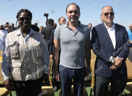 Irene Omondi, Zaatari Refugee Camp Director (L), Jordan's Prince Ali Bin Al-Hussein, founder of  the AFDP (Asian Football Development Project) (C) and Javier Tebas, President of La Liga (R) attend a celebration of La Liga socio-educational project, at the Big Sports House Stadium, in the Zaatari refugee camp, about 100 km north of Amman, Jordan, 14 July 2019. Zaatari refugee camp is only 10 km away from the Syrian border and houses some 80000 refugees, fifty per cent of whom are under the age of 18. The Zaatari socio-educational project was developed by La Liga in collaboration with the AFDP (Asian Football Development Project), it involves some 33 clubs of the Spanish League and aims to develop various projects favorable to coexistence, integration and adaptation of the participants and their families.