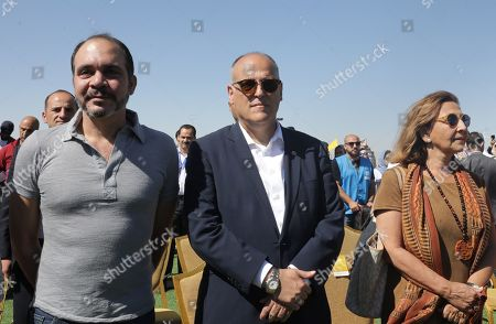 Stock Picture of Aranzazu Banon Davalaos Spanish Ambassador in Jordan (R), Javier Tebas, President of La Liga (C) and Jordan's Prince Ali Bin Al-Hussein, founder of  the AFDP (Asian Football Development Project)(L) attend a celebration of La Liga socio-educational project, at the Big Sports House Stadium, in the Zaatari refugee camp, about 100 km north of Amman, Jordan, 14 July 2019. Zaatari refugee camp is only 10 km away from the Syrian border and houses some 80000 refugees, fifty per cent of whom are under the age of 18. The Zaatari socio-educational project was developed by La Liga in collaboration with the AFDP (Asian Football Development Project), it involves some 33 clubs of the Spanish League and aims to develop various projects favorable to coexistence, integration and adaptation of the participants and their families.