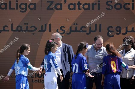 Javier Tebas, President of La Liga Foundation (2-L), Jordan's Prince Ali Bin Al-Hussein, founder of  the AFDP (Asian Football Development Project (4-L) and  Irene Omondi, Zaatari Refugee Camp Director (R) greet young beneficiaries during a celebration of La Liga socio-educational project, at the Big Sports House Stadium, in the Zaatari refugee camp, about 100 km north of Amman, Jordan, 14 July 2019. Zaatari refugee camp is only 10 km away from the Syrian border and houses some 80000 refugees, fifty per cent of whom are under the age of 18. The Zaatari socio-educational project was developed by La Liga in collaboration with the AFDP (Asian Football Development Project), it involves some 33 clubs of the Spanish League and aims to develop various projects favorable to coexistence, integration and adaptation of the participants and their families.