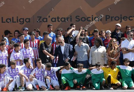 (2nd Row) Javier Tebas, President of La Liga (5-L), Jordan's Prince Ali Bin Al-Hussein, founder of  the AFDP (Asian Football Development Project) (6-L), Irene Omondi, Zaatari Refugee Camp Director (3-R), Aranzazu Banon Davalaos Spanish Ambassador in Jordan (2-R) and former football player Fernando Sanz (R) pose for a family photo during a celebration of La Liga socio-educational project, at the Big Sports House Stadium, in the Zaatari refugee camp, about 100 km north of Amman, Jordan, 14 July 2019. Zaatari refugee camp is only 10 km away from the Syrian border and houses some 80000 refugees, fifty per cent of whom are under the age of 18. The Zaatari socio-educational project was developed by La Liga in collaboration with the AFDP (Asian Football Development Project), it involves some 33 clubs of the Spanish League and aims to develop various projects favorable to coexistence, integration and adaptation of the participants and their families.