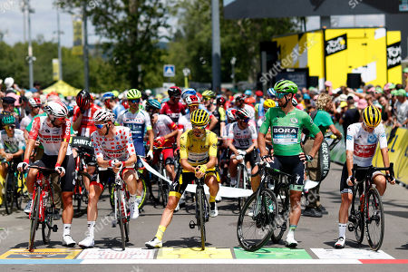 Riders with France's Julian Alaphilippe wearing the overall leader's yellow jersey, center, Italy's Giulio Ciccone wearing the best young rider's white jersey, right, Belgium's Tim Wellens wearing the best climber's dotted jersey, second left, and Slovakia's Peter Sagan wearing the best sprinter's green jersey attend the start of the ninth stage of the Tour de France cycling race over 170.5 kilometers (105.94 miles) with start in Saint Etienne and finish in Brioude, France