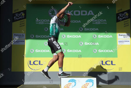 Slovakia's Peter Sagan celebrates on the podium after the ninth stage of the Tour de France cycling race over 170.5 kilometers (105.94 miles) with start in Saint Etienne and finish in Brioude, France