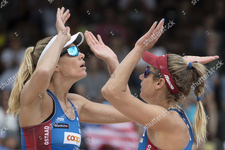 April Ross, right, and Alix Klineman of the United States celebrate their win in the gold medal match at the Beachvolley Worldtour Major Series event in Gstaad, Switzerland, 14 July 2019.