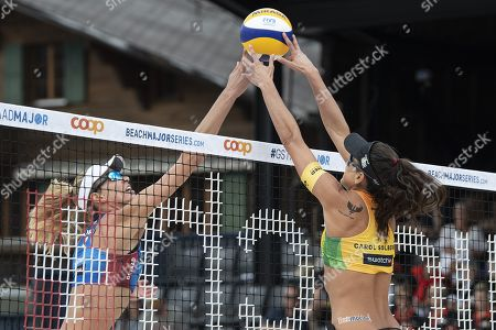 Stock Image of Alix Klineman of the United States, left, in action against Carolina Salgado of Brazil  during the women's gold medal match at the Beachvolley Worldtour Major Series event in Gstaad, Switzerland, 14 July 2019.