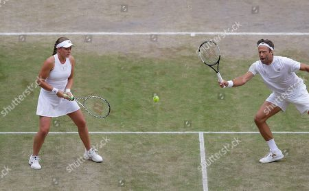 Latvia's Jelena Ostapenko, left, and Sweden's Robert Lindstedt in action against Taipei's Latisha Chan and Croatia's Ivan Dodig during the mixed doubles final match of the Wimbledon Tennis Championships in London