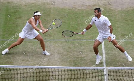 Taiwan's Latisha Chan, left, and Croatia's Ivan Dodig in action against Latvia's Jelena Ostapenko and Sweden's Robert Lindstedt during the mixed doubles final match of the Wimbledon Tennis Championships in London