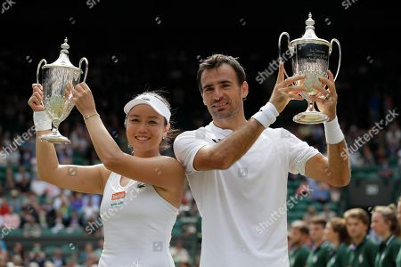 Taiwan's Latisha Chan, left, and Croatia's Ivan Dodig pose with the trophies after defeating Latvia's Jelena Ostapenko and Sweden's Robert Lindstedt during the mixed doubles final match of the Wimbledon Tennis Championships in London