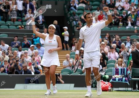 Stock Image of Taiwan's Latisha Chan, left, and Croatia's Ivan Dodig celebrate defeating Latvia's Jelena Ostapenko and Sweden's Robert Lindstedt during the mixed doubles final match of the Wimbledon Tennis Championships in London