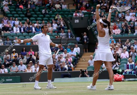 Taiwan's Latisha Chan, right, and Croatia's Ivan Dodig celebrate defeating Latvia's Jelena Ostapenko and Sweden's Robert Lindstedt during the mixed doubles final match of the Wimbledon Tennis Championships in London
