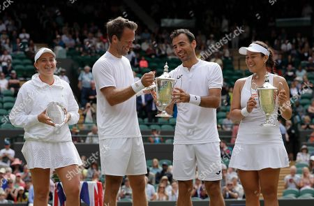 Winners Taiwan's Latisha Chan and Croatia's Ivan Dodig, right, pose with runners up Latvia's Jelena Ostapenko and Sweden's Robert Lindstedt after the mixed doubles final match of the Wimbledon Tennis Championships in London