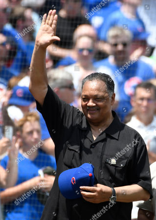 Reverend Jesse Jackson acknowledges the crowd before a baseball game between the Chicago Cubs and the Pittsburgh Pirates, Saturday, July, 13, 2019, in Chicago