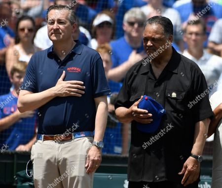 Reverend Jesse Jackson,Jesse Jackson. Chicago Cubs owner Tom Ricketts, left, and Reverend Jesse Jackson, right stand during the national anthem before a baseball game between the Chicago Cubs and the Pittsburgh Pirates, Saturday, July, 13, 2019, in Chicago