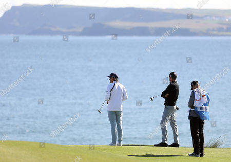 Rickie Fowler and Jimmy Walker of the U.S on the 5th green at Royal Portrush Golf Club during a practice round ahead of the 148th Open Golf Championship, in Portrush, Northern Ireland,. The Open Golf Championships takes place between 18-21st July