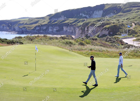 Rickie Fowler, right, and Jimmy Walker of the U.S walk onto the 5th green at Royal Portrush Golf Club during a practice round ahead of the 148th Open Golf Championship, in Portrush, Northern Ireland,. The Open Golf Championships takes place between 18-21st July