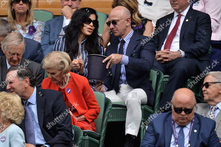 CEO and president of Amazon Jeff Bezos and Lauren Sanchez arrive to watch the mens singles finals on centre court tennis on Day 13 of the Wimbledon Tennis Championships 2019 held at the All England Lawn Tennis and Croquet Club.