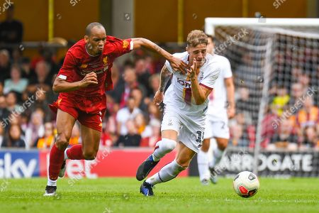 Stock Photo of Fabinho of Liverpool (3) and Tyler French of Bradford City (15) in action during the Pre-Season Friendly match between Bradford City and Liverpool at the Northern Commercials Stadium, Bradford