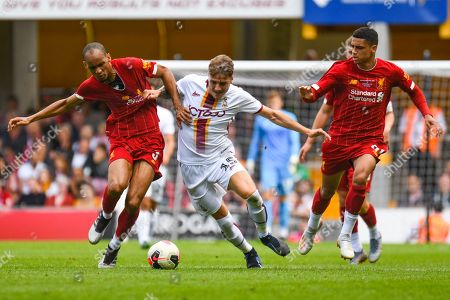 Stock Image of Fabinho of Liverpool (3) and Tyler French of Bradford City (15) in action during the Pre-Season Friendly match between Bradford City and Liverpool at the Northern Commercials Stadium, Bradford