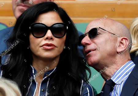 Amazon Founder and CEO Jeff Bezos (R) and his partner, US new anchor Lauren Sanchez, watch Switzerland's Roger Federer playing Serbia's Novak Djokovic during their men's singles final match for the Wimbledon Championships at the All England Lawn Tennis Club, in London, Britain, 14 July 2019.
